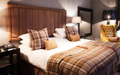 Luxury hotel bedroom decorated with Scottish flair, featuring a King sized bed.